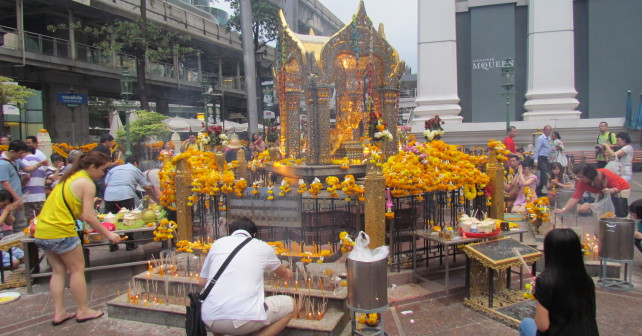 Devotees make their offerings in hope of finding luck